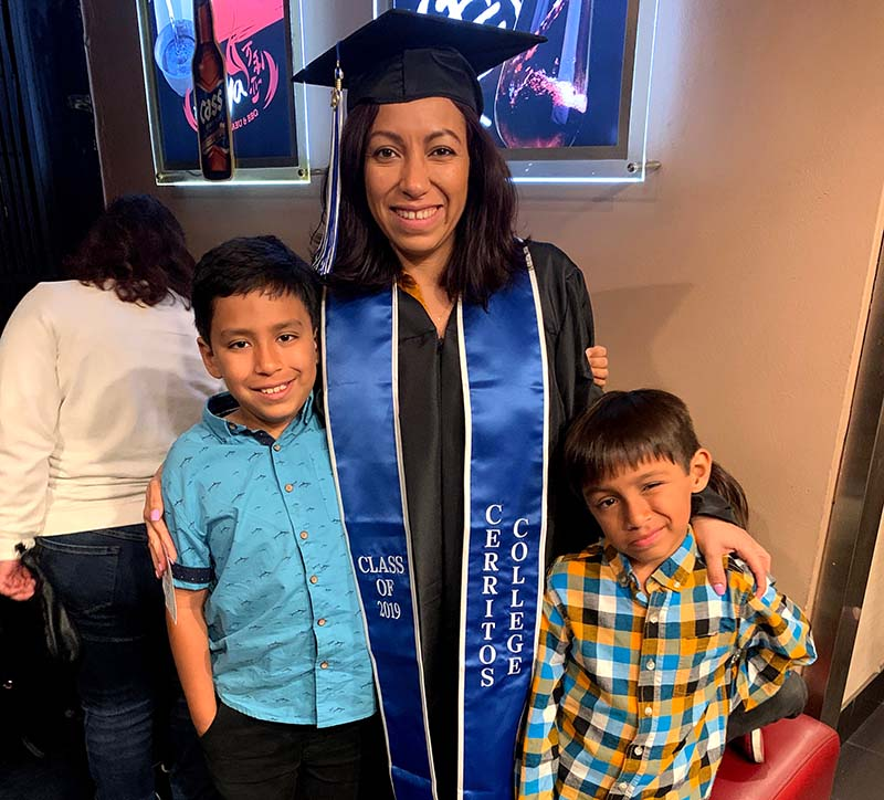 Andrea Paez with her sons at her graduation in 2019. (Photo courtesy of Andrea Paez)